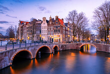 Amsterdam Netherlands During Sunset, Historical Canals During Sunset Hours. Dutch Historical Canals In Amsterdam