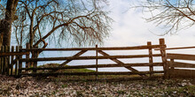 Old Wooden Gate On The Field Near The Yard