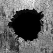 Cracked broken hole in concrete wall