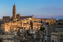 View Of The Sasso Baritano With The Famous Matera Cathedral Of Maria Santissima Della Bruna,  Illuminated By The Sunset Light. Matera, Basilicata, Italy Europe.