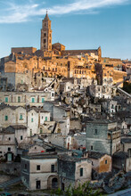 View Of The Sasso Baritano With The Famous Matera Cathedral Of Maria Santissima Della Bruna,  Illuminated By The Sunset Light. Matera, Basilicata, Italy.