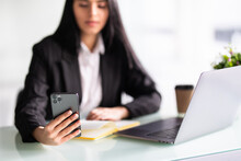 Portrait Of Business Woman Ceo Boss Chief In Front Of Laptop Netbook Holding In Hand Device Chatting At Work Place S