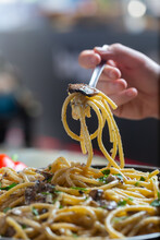 Man Eating Italian Spaghetti Pasta With Mushrooms And Herbs