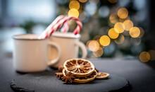 Dried Lemon Near Mugs With Christmas Candies