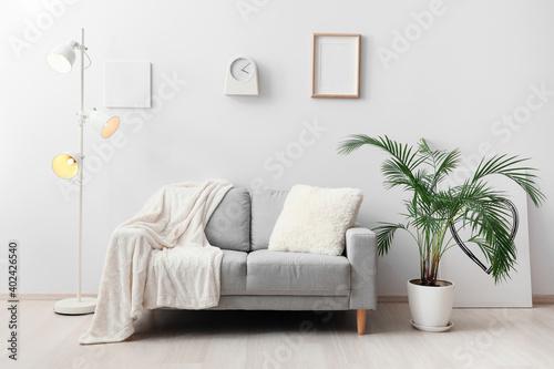 Stylish sofa in interior of living room