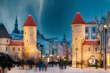 Tallinn, Estonia. Night Starry Sky Above Famous Landmark Viru Gate Gates. Street Lighting In Winter Holiday Evening. Christmas Xmas, New Year Vacation In Old Town. UNESCO Heritage. Altered Sky