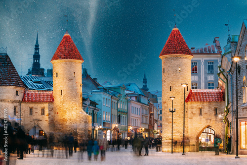 Tallinn, Estonia. Night Starry Sky Above Famous Landmark Viru Gate Gates. Street Lighting In Winter Holiday Evening. Christmas Xmas, New Year Vacation In Old Town. UNESCO Heritage. Altered Sky