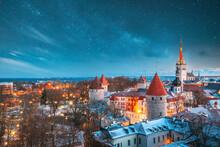Tallinn, Estonia. Night Starry Sky Above Old Castle Walls Architecture. Cityscape Skyline In Old Town. Winter Evening Night. Famous Landmark. Popular Destination Scenic. UNESCO Heritage. Altered Sky.