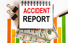 Notebook With Tools And Notes About Accident Report,business Concept