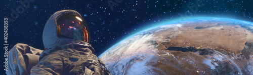 Obraz An astrounaut in outer space against the Earth on background - fototapety do salonu