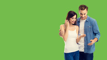 Love, New Parents And Happy Family Concept - Couple, Finding Out Results Of A Pregnancy Test. Green Color Background. Copy Space For Some Text.