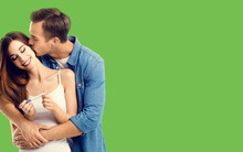 Love, Relationship, Happy Lovers, Family Concept - Couple, Finding Out Results Of A Pregnancy Test. Green Color Background.