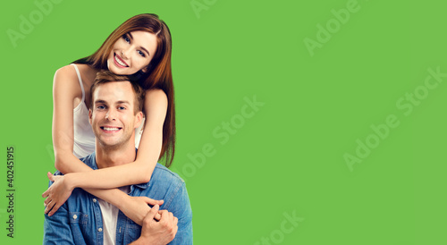 Love, relationship, dating, flirting, lovers, romantic concept - couple, standing close to each other, over green Wallpaper Mural