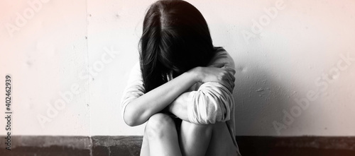 Fotografie, Obraz Unhappy woman sits and hugs her knees up to the chest,with upset and sad feeling