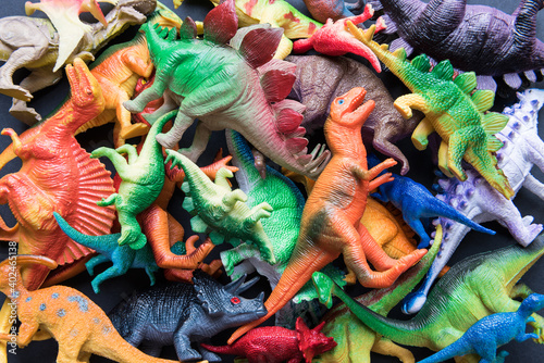 Pile of toy plastic dinosaurs