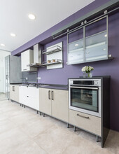 Modern Kitchen Interior With Beige Stone Pannels And Custome Made Details.