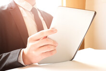 Businessman Reading On A Tablet Pc At The Office