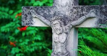 Ancient Hand Carved Crucifix Marks A Grave In Historic Cemetery