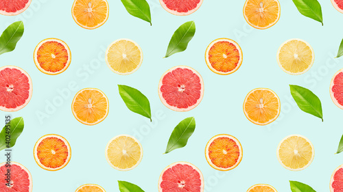 Fotografie, Obraz seamless pattern with citrus and leaves on a light blue background