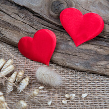 Red Hearts On Natural Wooden And Burlap Background. Valentine's Day Greeting Card. Eco Friendly Concept.