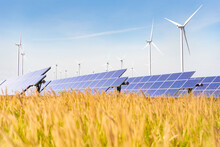 Solar Plant With The Wind Farm In The Summer Season, Hot Climate Causes Increased Power Production And If Strong Winds Will Add The Power Generated, Alternative Energy To Conserve The World's Energy