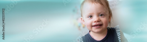 Canvastavla Portrait of happy baby girl; panoramic banner