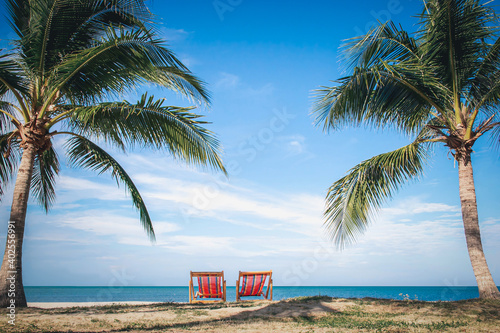 Two Beach Chairs between palm trees at the beach during a summer vacation-Vacati Fototapet
