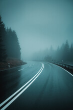 A Moody And Rainy View Of A Curved Mountain Road On A Cold Winter Day With Bad Weather And Heavy Fog And Misty Vibes. Harz Mountain, Harz National Park, Torfhaus, Germany