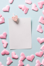 Romantic Sheet With Pink Hearts On Blue Background. Valentine's Day Greeting Card With Copy Space.