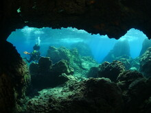 Scuba Divers Exploring Caves Underwater Cave Diving