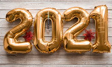 Text 2021 Made From Golden Inflated Balloons On A Rustic Wooden Table. Happy New Year Two Thousand Twenty One Concept. Hope For Vaccine Against Coronavirus Covid-19
