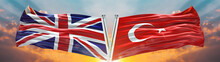Double Flag Turkey Vs United Kingdom Flag Waving Flag With Texture Sky Clouds And Sunset Background