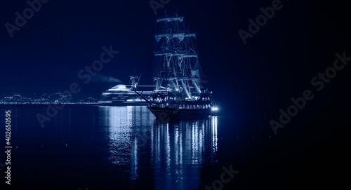 Fototapeta Pirate ship on the water of Mediteranean sea at night - Alanya, Turkey