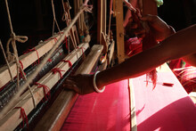 Handloom Weaver In India Working In Her Loom