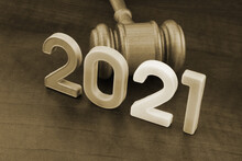 Gavel And Numbers 2021 On Wooden Table. Concept Of New Laws And Rules.