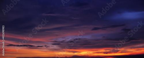 Obraz Dramatic tropical sunset sky panorama. - fototapety do salonu