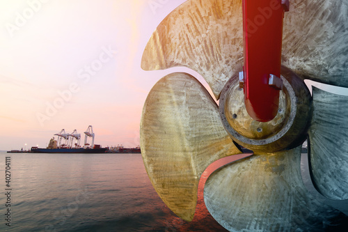 Tela Detail of black stern and ship propeller, rudder red after maintenance already b