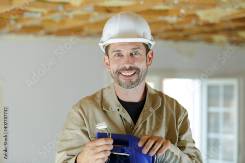 Canvas tradesman holding electrical junction box