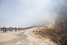 Ijen Volcano, Indonesia. Workers Mine Sulfur From The Crater Of The Volcano.