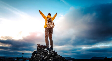 Man with arms up celebrating on top of the mountains - Hiker enjoying freedom on a hill at sunset - Freedom, sport, success and mental health concept