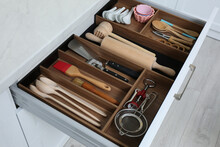 Open Drawer With Utensil Set Indoors. Order In Kitchen
