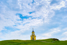 A Small Church On A Green Hill. Chapel On A Spacious Green Meadow.