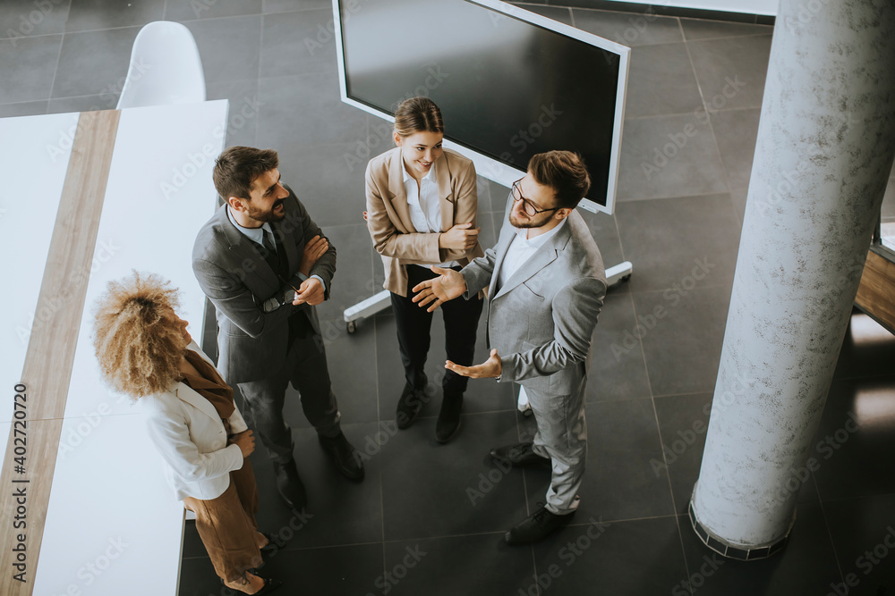 Fototapeta Multiethnic business people working together in the office