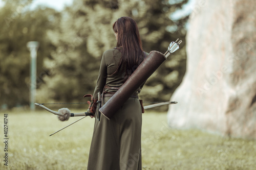 Canvas Print Young woman archer in green medieval costume