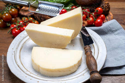 Fototapeta Cheese collection, Italian pasta filata aged cheese provolone from Cremona, Northwest of Italy obraz