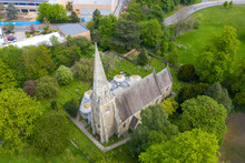 Aerial Photo Of An Old Church And Church Yard Known As Heslington Church In The Summer Time In The Town Of York In West Yorkshire In The UK