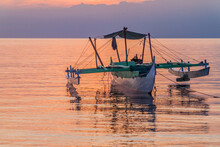 Sunset View Of A Bangka Double-outrigger Boat On Siquijor Island, Philippines.