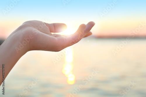 Obraz Woman enjoying beautiful sunset outdoors, closeup view - fototapety do salonu