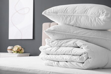 Soft Folded Blanket And Pillows On Bed Indoors, Closeup. Space For Text