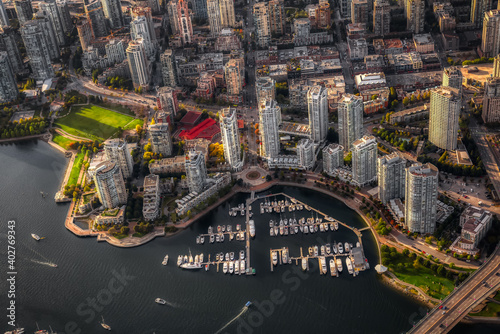 False Creek, Cambie Bridge, Marina, and Residential Buildings viewed from an aerial perspective. Modern City on Weset Coast. Downtown Vancouver, British Columbia, Canada.